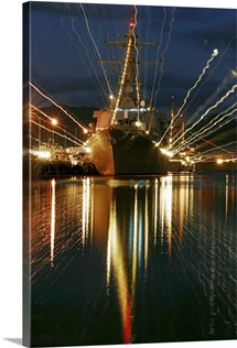 Holiday lights shine from guidedmissile destroyer USS Russell
