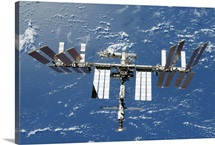 International Space Station backdropped by a blue and white part of Earth