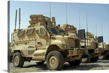 Mine Resistant Ambush Protected vehicles sit in parking area at Joint Base Balad Iraq