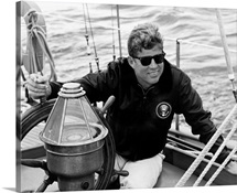 President John F. Kennedy sailing aboard his yacht