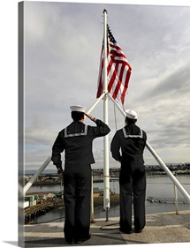 Sailors raise the national ensign aboard USS Abraham Lincoln