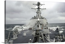 Sea spray whips across the deck of the USS Winston S Churchill