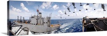 SH60 helicopters transfer ammunition between USS Harry S Truman and USNS Mount Baker