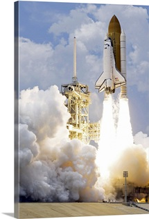 Space Shuttle Atlantis lifts off from its launch pad