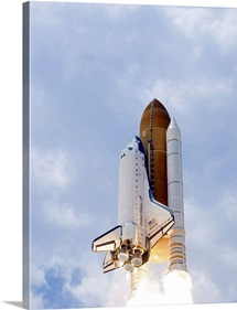 Space Shuttle Atlantis lifts off from its launch pad toward Earth orbit