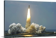 Space Shuttle Atlantis lifts off into the sky