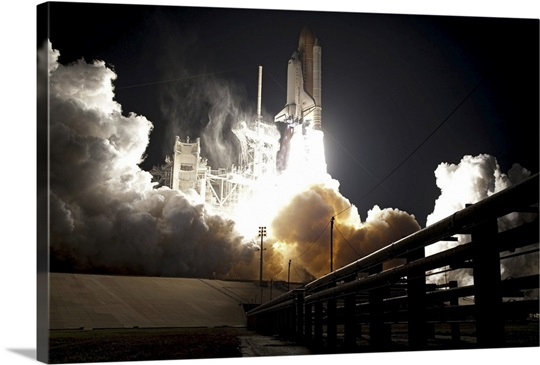 Space shuttle Endeavour lifts off into the night sky from Kennedy Space Center
