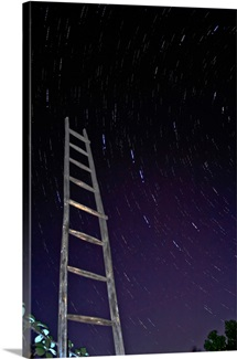 Star trails framworked by a wooden ladder