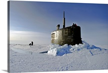 Submarine USS Connecticut surfaces above the ice