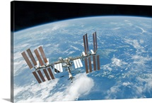 The International Space Station backdropped by Earths horizon