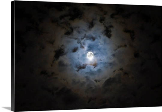 The Moon covered by a layer of clouds with a slight haze