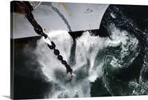 The starboard anchor of USS Ronald Reagan is released into the ocean