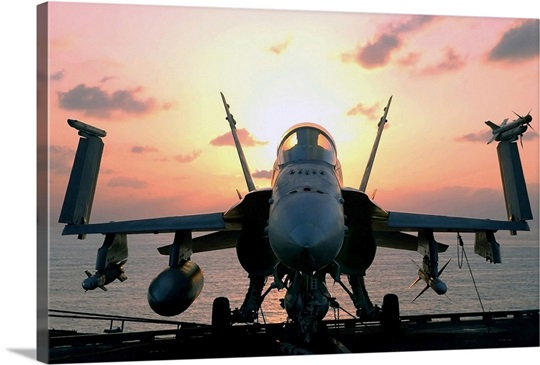 The sun rises on an F/A18 Hornet