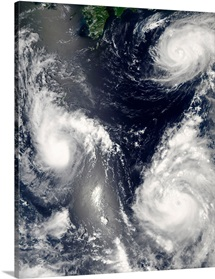 Three different typhoons spinning over the western Pacific Ocean