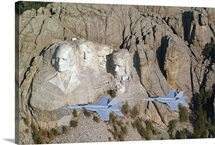 Two F/A18E Super Hornets conduct a fly by of Mount Rushmore
