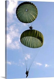 U.S. Army Soldiers parachute down after jumping from a C 130 Hercules
