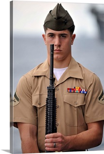 U.S. Marine presents arms during an anniversary ceremony