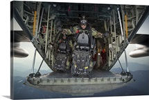 U.S. Navy SEALs combat diver prepares for HALO jump operations from a C-130 Hercules