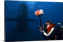 Underwater photographer takes photos of a US submarine
