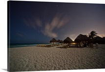 View of the beach at night in Cancun Mexico