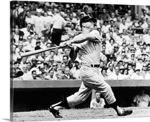 Mickey Mantle of the New York Yankees, hitting his 49th home run of the season