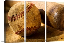 Antique baseball with baseball bat