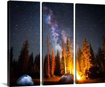 Milky Way over camp with illuminated tents in Uinta Mountains, Utah.