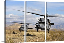 Two HH60 Pavehawk helicopters preparing to land