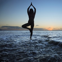 Hawaii, Oahu, Fit Young Girl On The Beach Doing Yoga On The Rocky Coastline