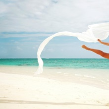 Hawaii, Oahu, Lanikai Beach, Ballet Dancer Leaping Into Air With White Flowing Fabric