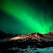 The Northern Lights over Wolverine Peak in the Chugach State Park, Alaska