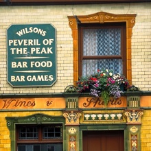 The tiled exterior of the Peveril of the Peak pub in Chepstow Street, Manchester.