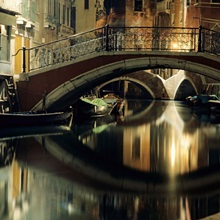 A night view of a canal in Venice, Italy