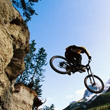 Mountain biker with Ha Ling Peak in the background, Alberta, Canada