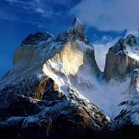 Sunlight shines on the summits of Cordillera de Paine