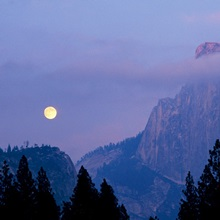 The moon rises over Half dome in Yosemite National Park, California