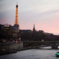 The Seine River and the Eiffel Tower during a red sunset in Paris, France