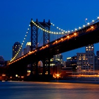 Twilight view of the Manhattan Bridge spanning the East River