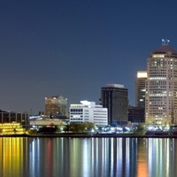 Buildings in a city lit up at night, Detroit River, Detroit, Michigan,