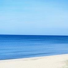 Michigan, Holland, beach chair overlooking Lake Michigan