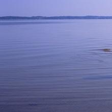 Reflection of two adirondack chairs in a lake, Lake Michigan, Michigan