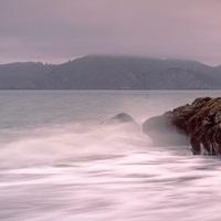 Waves breaking on rocks, Golden Gate Bridge, Baker Beach, San Francisco, California