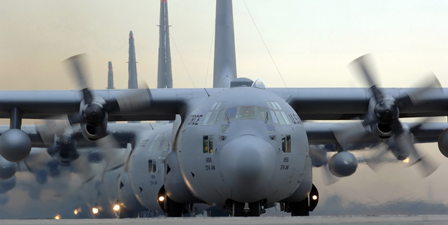 C130 Hercules aircraft taxi out for a mission during a si...