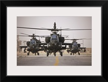 A group of AH-64D Apache helicopters on the runway at COB Speicher