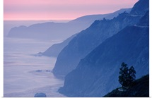 Mountains jut from a misty sea at sunset, Big Sur, California