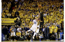Kyrie Irving of the Cleveland Cavaliers shoots a three-point basket