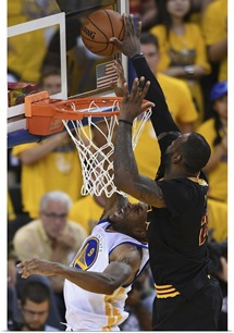 LeBron James of the Cleveland Cavaliers blocks a shot by Andre Iguodala