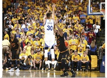 Stephen Curry of the Golden State Warriors shoots against Tristan Thompson