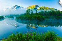 Summer scenic of mist over Moose Ponds and Explorer Glacier in Portage Valley, Alaska