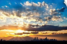 Sun Bursts over Denver during Sunset; Denver, Colorado